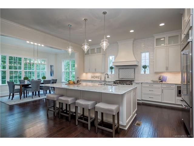 Absolutely stunning BRAND NEW custom home in established Stratford Hall!! Bright, open & airy this gorgeous home boasts gleaming hardwoods, white gourmet kitchen w/marble tops & stainless steel appliances open to large great room which steps out to huge porch overlooking wooded backyard!! Amazing walkout basement with bar area, huge great room & bdrm w/ full bath.Top of the line finishes throughout the 3 floors! This home is absolutely immaculate and 100% move in ready! Prepare to fall in love!
