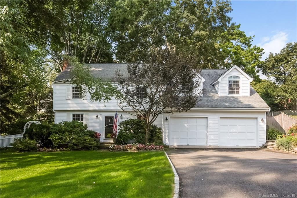 This lovely four bedroom, three full and one half bath colonial is located in one of Darien's most coveted neighborhoods. Updated kitchen with stainless steel appliances and granite countertops opens to a family room with vaulted ceiling and skylights. Private patio and fenced-in yard add to the charm.