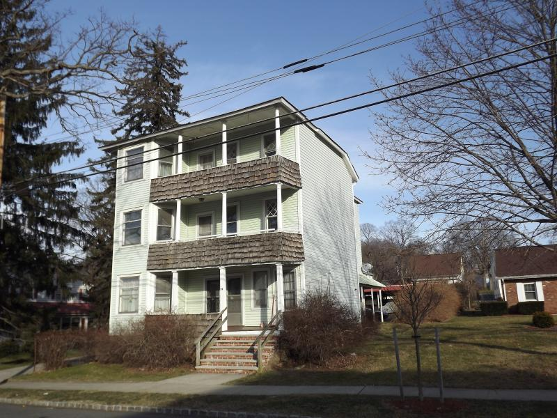 2 bedroom apartment on 3rd floor in historic downtown Stanhope.  Off street parking (2 spaces) in rear of building. Separate entrance. Heat included.  NO PETS. NO SMOKERS. Large rooms, covered porch, plenty of storage space.