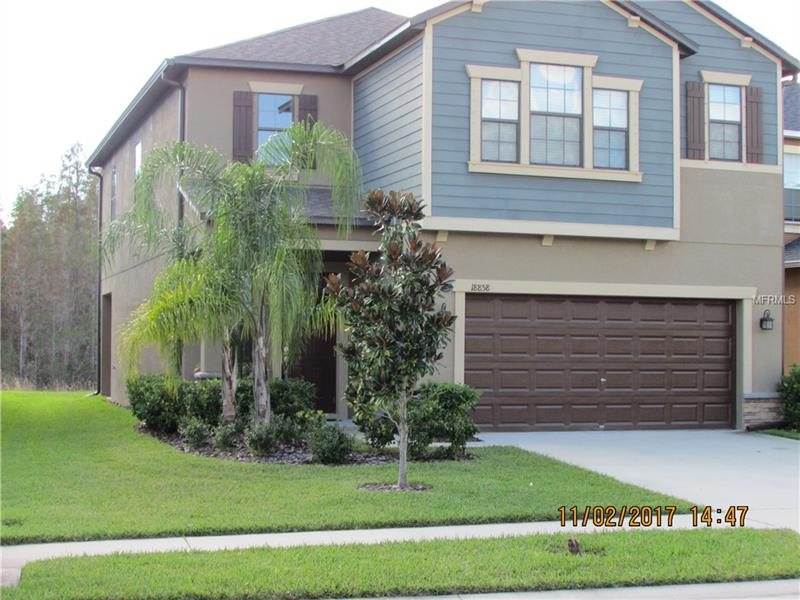 """**4% Commission to Selling office!** Gorgeous Conservation views from the family room, dining room and kitchen and lots of beautiful windows to make this happen. And even better views from the lanai. Located North of Tampa in Pasco County. Must See, Like brand new home in Beautiful Concord Station. 2,349 SF, 4 bedroom, 2 ½ bath, 2 car garage, Sheffield model, Eco-Smart energy efficient home on a cul-de-sac street. Loaded with EVERYTHING: Low-E dual pane insulated windows, 18""""x18"""" Tile, 2"""" Faux wood blinds, prewired alarm, staggered maple cabinets with crown molding, 15+ SEER High Efficiency HVAC, Mohawk carpet, rounded corner beads, Moen plumbing fixtures with chrome finish, programmable thermostat, washer and dryer. Kitchen features Granite counters, stainless appliances, island, Large pantry and 42"""" solid wood cabinets! The clubhouse features a clubhouse with fitness center, Resort Style Pool, tennis courts, basketball courts and playground. Prime Location, close to the Veterans, I-75, fantastic shopping and restaurants, Tampa Airport, and some of the highest rated schools in the area. No flood insurance required! The CDD is already included in the tax bill."""