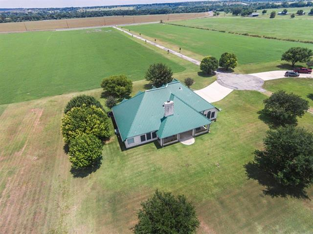 Ag Exempt! Multi-Generation Home on 11 Acres! Fresh paint throughout, new carpet in Family areas and bedrooms!  New stainless steel gas range and recent stainless dishwasher. 2 Full Owner suites on each side of this plan, each w/a private bath and walk-in closets. Great for extended family and/or guests! Open and bright plan with high ceilings, large bedrooms, and ceiling fans. Plenty of space in the large center-island kitchen. Plenty of room to spread out! Close to COTA, Airport, and Downtown ATx!