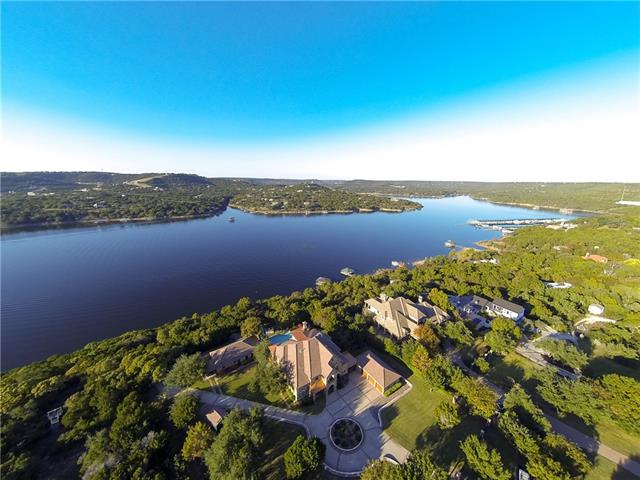 Gated Estate located on deep water Lake Travis, allowing for a private boat dock, accommodating any size vessel. Nestled on just under 10 acres, with manicured landscape and a paved driveway and stone step walkway to the lake. Built in 2007, custom designed to allow exceptional views from every level of the home. Resort Style Pool, allows for amazing views of the lake and hill tops. Lakeside Living with Family in Mind, perfect for your primary or second home dream!! See Floor Plan within Virtual Tour.