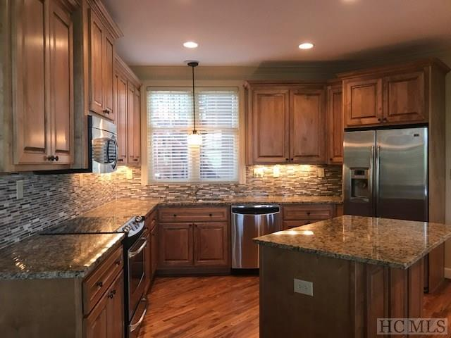 """Completely remodeled and updated to include frameless showers, custom cut beveled mirrors, shiplap, natural cork wallpaper in central powder bath, Kohler 8"""" round rain shower head in master bath, artistic pendant & updated lighting throughout, freshly painted walls, ceilings and trim."""