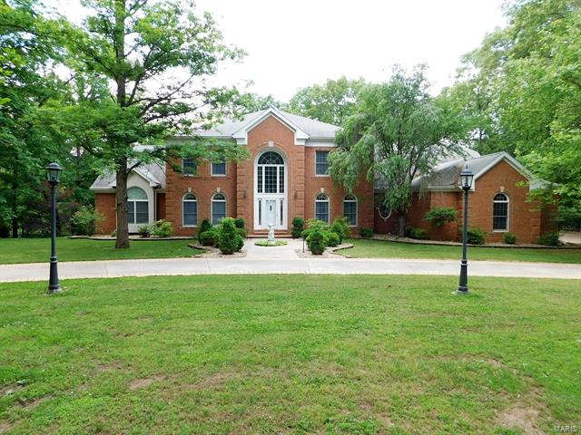 Living is easy in this impressive, generously spacious home. The grand entryway w/ a sweeping staircase draws you into a voluminous layout made for entertaining. The 2-story great room w/ access to the rear deck is the dramatic focal point of the main level complete w/ wet bar & fireplace, accompanied by a formal dining room, tremendous kitchen, breakfast room, hearth room off of the kitchen w/ a second fireplace, den, a stately master bedroom, & master bath.  The second floor offers another option for a master bedroom suite w/ bath, large loft area, two additional bedrooms & a guest bath. The amenities continue to the finished lower level w/ a living room, third fireplace, kitchenette/wet bar, rec room, exercise room complete w/ sauna that stays, bedroom, bathroom, & access to a 15X26 screened in porch. Enjoy the views of your 5.29 wooded acres, complete with stocked pond, from the back deck or from your in ground pool. Guests will sure to be impressed at the turn of every corner!
