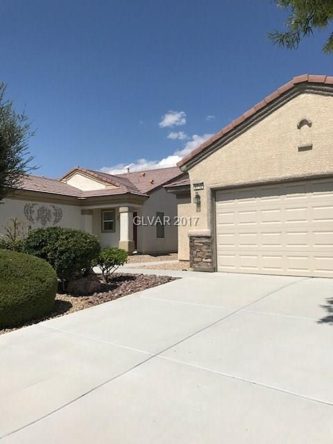 Popular Sun City Aliante over 55 community. Immaculate move in condition,3 Bedrooms, 2 full baths. All appliances included. Granite kitchen counter tops, with breakfast nook. Tile flooring throughout with carpet in bedrooms. Open floor plan, separate master suite with walk in closet and attached full bath. Laundry room with cabinets. Walk out covered patio.