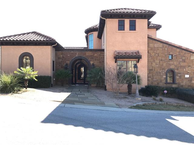 Enjoy this uniquely constructed Spanish Style Mediterranean Villa, inspired by the Italian countryside, overlooking scenic lake views. Walking distance to the Rough Hollow Yacht Club, pool, The Grill.Highlights: 3 Levels:  House is multi-leveled with entry on the 2nd level (main level) through a courtyard. Once in the courtyard, a private detached guest suite is to the left and the entry to the main house is directly in front.