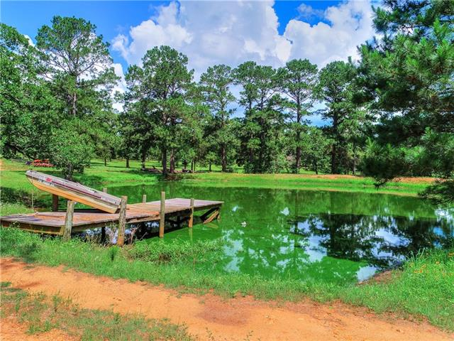 Breathtaking skyline views, rolling hills and highly desirable location in the lost pines of Smithville--only a 45 minute drive from Austin! The property is a combination of 3 tracts of land totaling 50 acres. Pastures seeded with Coastal/Bahia; medium to large, mature oaks and pines scattered throughout the 50 acres.  Beautiful pond on the property with dock, great for fishing and relaxing, and 40 x 30 metallic building also included, would be an excellent workshop or great for storage!