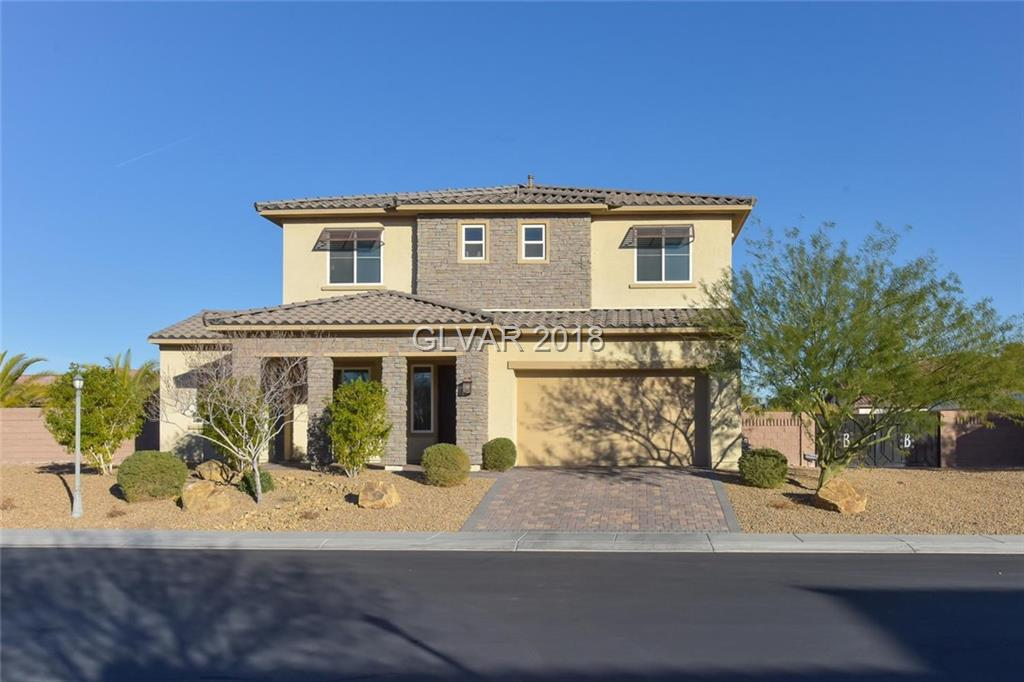 WOW! This beautiful home is on a large homesite with RV gate. Highly upgraded! Huge kitchen has built in refrigerator,large island with granite counters and stainless appliances. 2 fireplaces, built ins. Tile and wood floors, wrought iron staircase,Solar panels,surround sound prewire and alarm system  just to name a few! Mstr. bedroom with huge covered observation deck over looks the gorgeous pool and spa. Upstairs laundry with sink. Must see!!