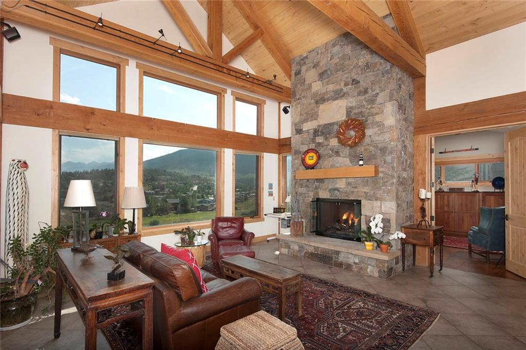A magnificent custom home situated on HOA open space, wetlands and Soda Creek. Sweeping views to the Continental Divide and other surrounding mountains. Located at the end of the cul-de-sac, you'll enjoy the peace and quiet surrounding your home. Large, natural stone gas or wood burning fireplace, exposed wood beams, vaulted ceilings, entertainers kitchen, heated garage with vehicle lift, wine cellar and more. Centrally located and close proximity to hiking/biking trails and elementary school.