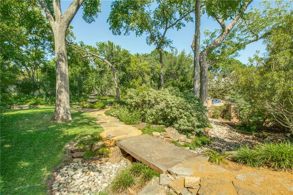One of the largest lots in JanMar neighborhood.Priceless landscaping & room for entertaining on expansive .7 acre lot. Mstr BR w sitting area,His&.Hers Closets,Mstr Bath w dbl vanities,2 BR's down w en suite baths.Bright & inviting Chef's Kitchen w granite tops,6 burner cooktop,wet bar,ice maker, & wine cooler.Kit opens to Family Den w built ins, Brkft room & sep desk nook.Formal LR&DR, Office,Mudroom,Exercise room, & Craftroom & Utility all downstairs. 2 additional BR upstairs with full bath. Updates in 2008 include 3 car garage,New HVAC, Electrical,Plumbing,Tankless HWH,complete pool remodel,2 Sump Pumps, French Drains,New windows, Home water purifier system.Unique property for luxurious living inside & out.