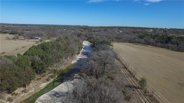 Big views and cool water only 45 minutes from North Austin. Magnificent hilltops shaded by large oak trees and views of the hill country/creek bottom. Nearly one mile of coveted Rocky Creek meanders through this wonderful ranch. Rocky Creek is one of the largest creeks in the area with stone banks, crystal clear swimming holes and bountiful fishing opportunities. This ranch is a well rounded gem with views, awesome water features, nice home, large trees, cattle grazing, hunting and additional build sites.