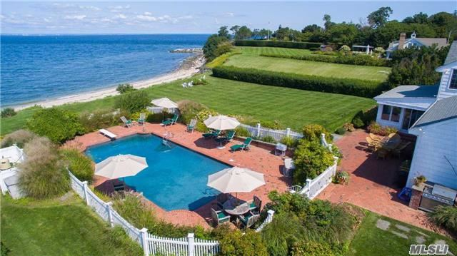 "Hamptons-Style Waterfront On Long Island Sound--Open Your Door, Walk Out To Sandy Beach & Enjoy Seaside Living.  Situated Atop A 27'Bluff Protected By An Expansive Stony Revetment, This Property Offers Spectacular Sunsets & Moonsets Too! This Custom Built Farm Ranch Feels Like A ""Home"" And Features Geothermal Heating &Cooling, Gourmet Kitchen W/Fireplace/Viking/Sub-Zero."