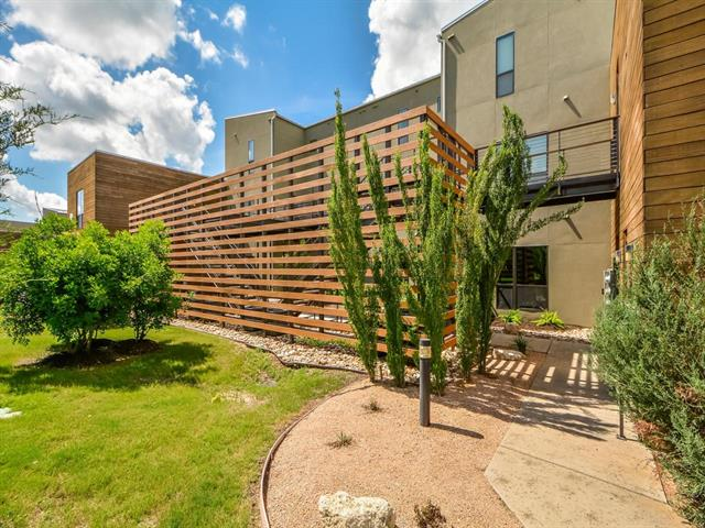 Gorgeous contemporary condo in Waterstone on Lake Travis. ~ THIS UNIT HAS MANY ADDED FEATURES: NEW A/C COMPONENTS UPSTAIRS AND DOWNSTAIRS IN 2018, REMOTE CONTROLLED WINDOW SHADES, HARDWOOD FLOORS, RETRACTABLE SCREEN DOOR TO BALCONY, REMOTE CONTROL CEILING FANS, LED LIGHTS, SOFT-CLOSE KITCHEN CABINETS & DRAWERS, SINK GARBAGE DISPOSAL BUTTON, LAUNDRY CLOSET CUSTOM SHELVING & WASHER DRAIN PAN, WATER SPIGOT TO BALCONY, 3 LARGE STORAGE RACKS IN GARAGE. ~ Furnished is an option.