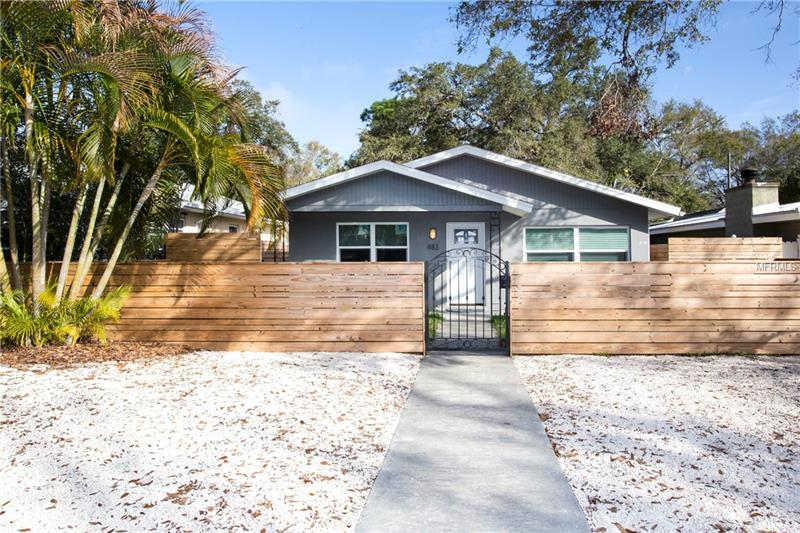 Mid Century Style home in the heart of downtown St. Pete. As you walk through the front door, a feeling of openness awaits you with modern detail at every glance. This 3 Bedroom, 2 Bath home with a detached 2 Car Garage is newly renovated from top to bottom and features high end waterproof vinyl laminate floors throughout, Jeldwen energy efficient hurricane windows, New hurricane exterior & paneled interior doors, New roof only 2 years old, New A/C and much more.  Modern wht kitchen with pullouts and upper glass cabinets, Brazilian teak countertops and new stainless-steel appliances. Mid Century Fencing throughout the property with Iron front gates that creates the perfect setting for outdoor entertaining or your morning coffee in your private courtyards. Walking distance to Coffee Pot, Fresh Market and Trader Joe's the perfect location.