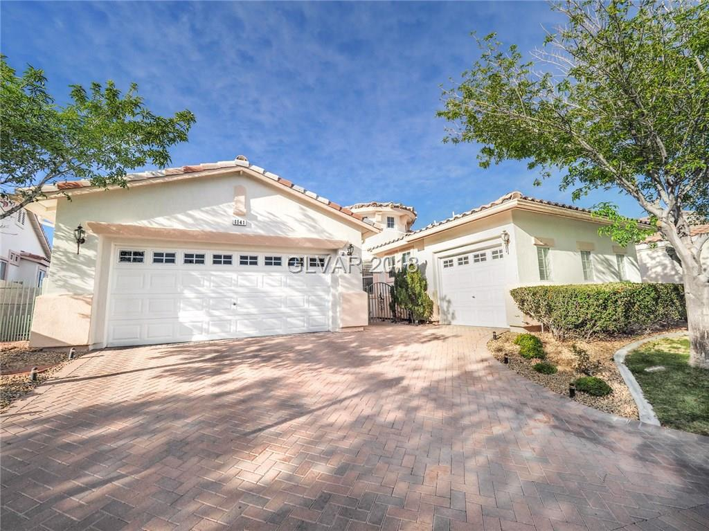 Gorgeous single story,3 car garage,mountain views,sits high on top of the hill,neutral colors,bright,light,functional & airy flpn,vaulted cathedral ceilings,highly upgraded,gourmet kitchen w/island,S/S appliances,trash compactor,corian cntps,wet bar w/wine rack,covered patio,courtyard,double glass beveled doors,workshop,huge master suite w/closet organizer,ceiling fans,custom window coverings,pavers,formal dining room or office,huge family room.
