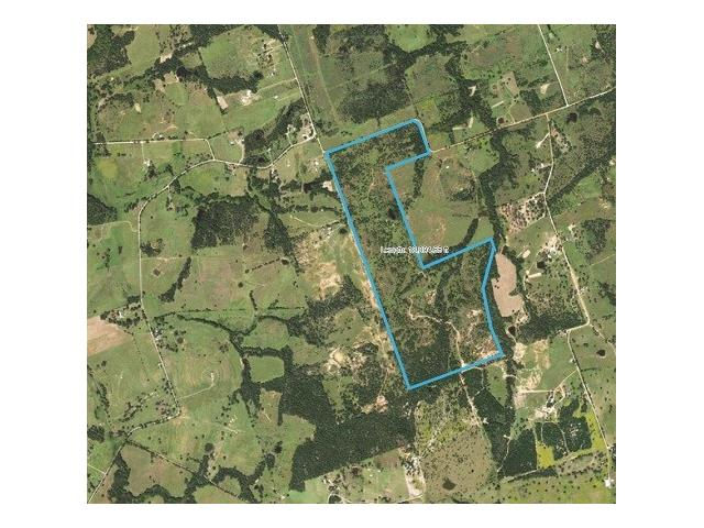 233 Acres of mostly wooded ranch land; Pond & wet weather creek on property. Currently used for Cattle/Horse grazing, 5-strand barbed wire fences, native grass, post oak , cedar and Yaupon trees. Electricity on property; Ag exempt. Wild Game, including White-Tailed Deer, Hogs, Dove.