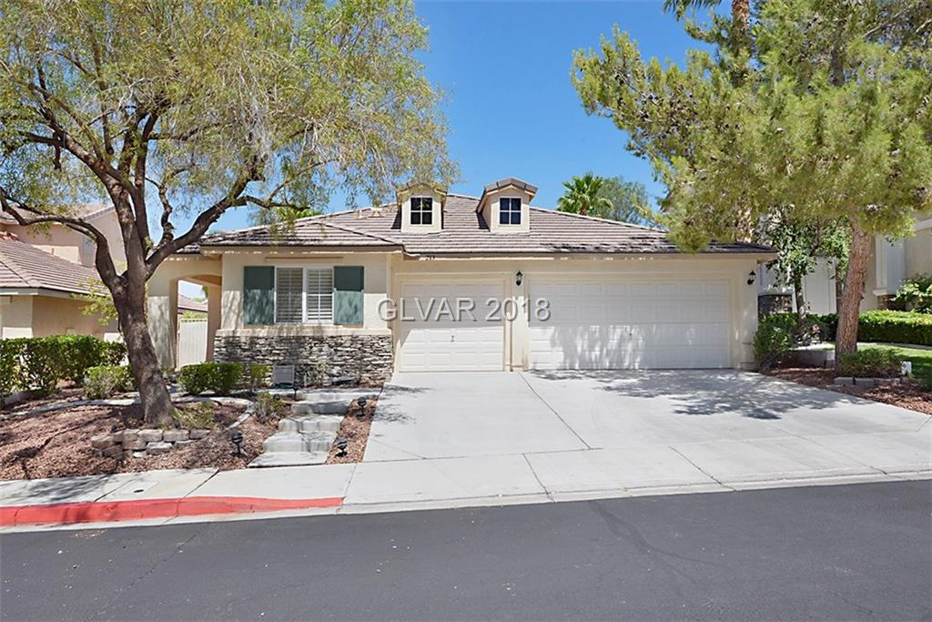 Stunning single story, 3bd/3ba home in a gated community in Green Valley Ranch. Walking distance to The District. This home features a separate guest room, office, big family room, open kitchen with island, shutters, and a stunning backyard.