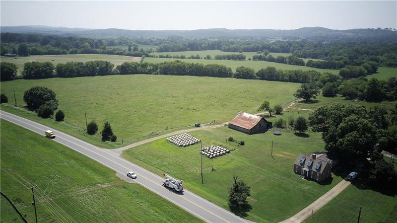179 acres zoned AG, 1 acre with farmhouse zoned Residential. Great commercial, residential, or farm potential