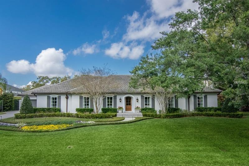 A showcase manicured lawn greets you each day when you arrive home to your beautiful home.  Understated elegance with tile roof, custom copper gutters, solid 6 light front door all say