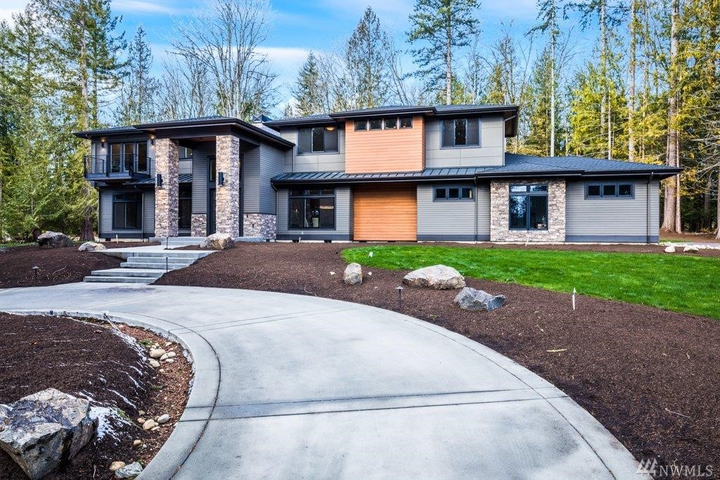 Stunning NW Contemporary home by NW Builder Group on serene .8-acre lot. Luxurious, modern design, no detail spared offers a dramatic Great Room, Meile/Subzero kitchen with large island, slab Quartz counters & Butler's Pantry, formal dining, main floor room w ensuite, den, and bonus room. Curved stairs lead to master w balcony, frpl & spa-like bath w 3 add'l bedrooms, gym and theater. Outdoor covered patio, 1300 sq ft garage and expansive yard, complete this elegant, sophisticated Masterpiece.