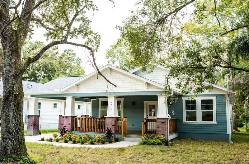 This craftsman home is centrally located in Old Seminole Heights and minutes away from Downtown Tampa, The Riverwalk, and Ybor City. As you open the door to this beautiful new bungalow home, you'll be greeted with an open floor plan. 9ft 4in ceilings and a custom trim package throughout await you. The kitchen is a chef's dream featuring shaker cabinets, recessed lighting, a pantry and granite countertops; as well as stainless steel appliances. The back door from your kitchen leads you to your private back patio with views of Mature Grand Oaks on your oversized 1/4 acre lot. The master bedroom features crown molding and a large walk-in closet. The master bath features frameless glass around the shower, standalone tub and dual vanities with granite counters. This bungalow is built to last with cement board siding, hurricane impact windows and doors. Schedule a showing today!