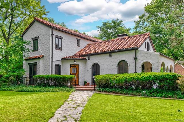 Architecturally stunning Spanish Revival home in sought-after Claverach Park. From the moment you enter this unique home, you will be enthralled with the dramatic living room with a 21' ceiling graced with beamed trusses, wood-burning fireplace, etched art glass & 6 sets of arched french doors, one leading to a covered porch. The dining room is elegant with a wrought iron decorative gate & french doors. Gorgeous terrazzo floors. Newly updated kitchen with granite counters, gas stove, walk-in pantry & breakfast area. Off of the kitchen is a family room with doors that lead to a new, expansive patio & the private backyard. Main floor master bedroom suite featuring a large walk-through closet & a master bathroom with a skylight, granite topped dual vanity, tub & separate shower. 2nd full bathroom on the main level. Upstairs are 3 bedrooms, a large bathroom with vitrolite tile & an upstairs deck.  An abundance of light streams into this home with most rooms having 3 sides of windows.