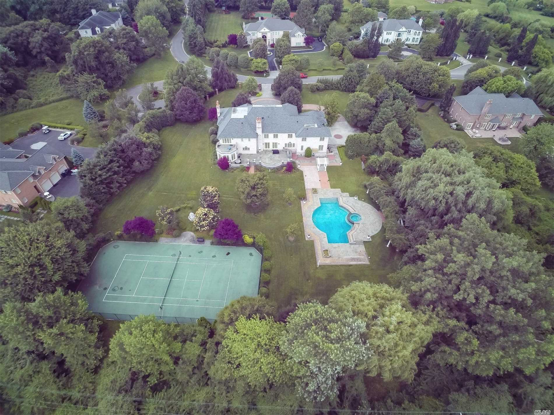 Custom Built & Beautifully Maintained 10K+ Sf Brick Colonial On Quiet Cul-De-Sac. Home Boasts Large Spacious Rooms Throughout. Gourmet Eik W Wonderful Breakfast Nook. Great Home For Entertaining. Perfect For Large Family W 8 Full Bedrooms & 8.5 Full Bathrooms. 2500 Bottle Wine Cellar & 16 Seat State Of The Art Theater. Backyard Paradise W Gunite Pool & Tennis Ct On 2.53 Flat Acres. Gated Property.