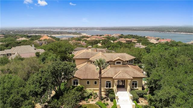 Fabulous Lake views with lake access to the main body of Lake Travis. Reserved Boat Slip conveys. Home has been tastefully remodeled including new paint; updated kitchen & bar area; Private master suite with new bath area including freestanding tub, walk-in shower, new mirrors/floors/toilet and lighting.  Gorgeous views of the lake from the Master Suite! Multiple decks for outdoor living. Professional tropical landscaping, a huge pool for soaking up the sun. Professional Exercise Room & Exec Office.