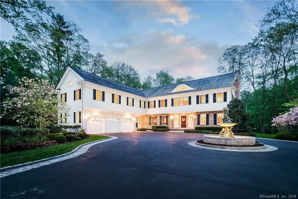 Only a 7 minute drive from downtown Westport, this 2002 home is close to everything! The entrance to the property is guarded by an impressive 6 foot stone wall, which greatly adds to the home's already regal feel. The workmanship and attention to detail is evident from the moment you walk into the impressive, double height foyer at 107 Good Hill Road—where every level of the home is lined with beautifully detailed, multi-piece crown molding. With large rooms and over 8,500 square feet, this home feels grand, yet also warm and comfortable. It is perfectly proportioned for a group of any size. The 1st floor features a Chef's kitchen with a 10 foot Danby marble island, custom cabinetry, and high end appliances including a Subzero Refrigerator and freezer, double Viking wall ovens, 3 deep stainless steel Franke sinks, 2 dishwashers, a Viking wine cooler and Butler's pantry. A spacious and welcoming family room, office, formal living & dining room, breakfast area, mudroom, and 2 half baths round out the first floor. The 2nd floor includes an elegant landing, a master suite with 2 walk in closets as well as dual shoe closets, a large guest suite (could be used as a 2nd master), 2 additional bedrooms w/ en-suite baths & walk in closets, and large bonus room that's perfect for a playroom, studio, or additional bedroom. The third floor is equipped with a full bath, and can be used as an office, additional bedroom, or anything else.