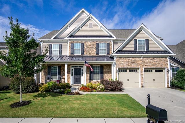Beautiful 2 story 5BR/4.5BA/ Bonus room. Lustered hardwoods in main areas on 1st floor, chef's kitchen w/ Island, granite countertops, dbl ovens & SS appliances, breakfast area, Formal Dining Room and study. Guest Suite on Main / private full bath. Huge upper level Master Bedroom / 3 secondary spacious Bathrooms & large Bonus room with sink and refrigerator making it the perfect Man Cave or Kid's playroom. Fenced rear yard. Beautiful Amenity Center, Olympic size pool with slide, baby pool, 24 hr fitness center, tennis courts, walking trails and boating. The Fort Mill and Tega Cay areas are growing extremely fast! Get in while you still can! This close to Lake Wylie and Fort Mill Schools!!! Unbelievable and a must see for the family looking for a fun family oriented Community! Look no further, it's all here!