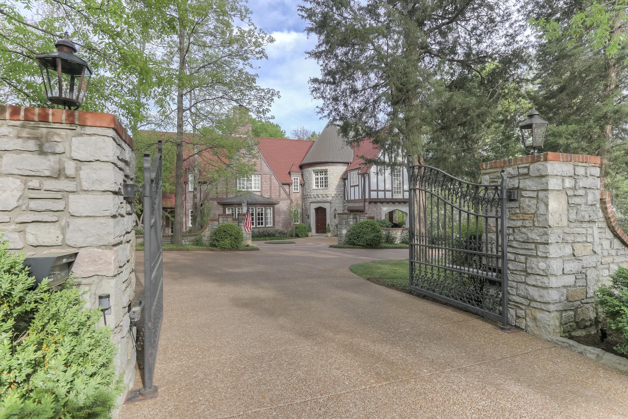 Truly beautiful English Tudor on coveted lot & street in Belle Meade. Fabulous design & quality with architectural details including grand rooms, impressive trim work & built-ins. Granite, stone & hardwood floors throughout. Space for elevator. Media room has wiring to be a recording studio. Geothermal heat/air. Act quickly, this home is special!