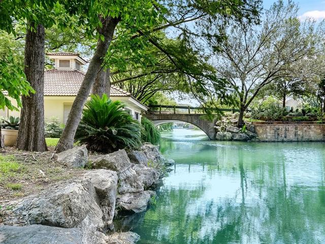 Lake Austin!! First time on the market!!! Exquisite home on a fabulous lot in The Island gated community on Lake Austin. Wonderful open floor plan with views and great outdoor areas with verandas. Two boat garage with slips and lifts. On the quiet canal with easy access to lake. Comfortable guest house by the lake and near the boat dock. A rare home site and fabulous home. Minutes to downtown Austin and the University of Texas.