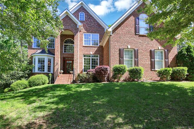 Fabulous full brick estate in Lake Shore in the heart of Tega Cay & minutes from the lake!  Upon entering you will be greeted with a great flow on the main floor that is washed in natural light. The highlights include two-story great room, large kitchen with eat-in breakfast area, formal dining room, office/study with french doors & wonderful master retreat. Lower level features private living space including bedroom, spa bath, wet bar and lounge/game room. Upper level features 3 bedrooms & bonus/add'l bedroom with bath.  This home is full of small details: separate thermostats allow different temperatures on each floor, exterior solar light system, irrigation system, no HOA association fees. Exterior of the home features wonderful curb appeal, front landscaping, large main floor deck among the tree tops, lower level patio, 3-car garage & fabulous wooded ravine in back. Community located in desired Fort Mill schools!