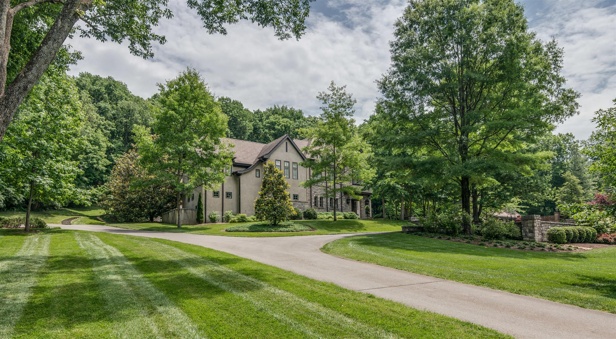 Unfussy, friendly and pure quality fun family home! Attention to thoughtful details throughout main & guest/pool house. Heated saline pool, screened porch w/ fireplace, park-like setting.