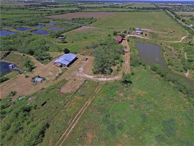 Parcel #297680 for 213 acres w/old restaurant & barn, plus parcel #297679 for .44 acres w/1352 sqft home included in sale. Seller prefers to keep 1 acre truck yard. Per owner, there is an additional 12 (unclaimed) acres fenced w/this property. Formerly the Catfish Hill Farm & Restaurant. Home at 6203 Wolf Ln, large barn, old restaurant(poor condition). 3 very large ponds/lakes plus many more small ponds, 2 creeks, views of Austin. 3rd entrance off Meurer. Approx. 70 acres cleared. Deer, turkey, wild pigs