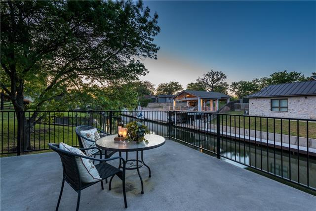 LAKE LBJ: property w/ 80ft of waterfront. Living w/ towering ceilings, wet bar & fireplace. Stainless kitchen w/ granite counters, eating bar, glass cook-top, & pantry. Breakfast area & formal dining. Study w/ en-suite bath. Master w/ water views & en-suite bath. Three guest rooms w/ an en-suite baths. Multiple access points to patio makes it is easy to enjoy the setting. Boat house w/ elec boat lift. Deck above for views of the water. Live a life of luxury w/ this beautiful lake in your own backyard!