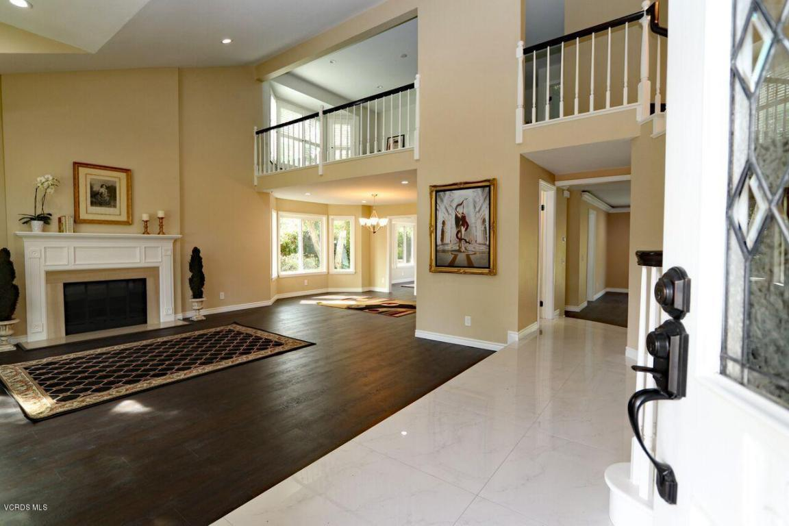 This is the show stopper exquisitely renovated top to bottom in much sought after Morrison Estates/Sutton Valley with top rated, acclaimed Oak Park schools. This 4 bedroom, 4 bathroom home is smart wired & ready, just bring your hub and cell phone! Dramatic 2 story entrance with porcelain tiles and dark WPC flooring throughout the entire home, upstairs too-no carpet. Kitchen is complete with center island, wine refrigerator, granite counters & stainless appliances. Family room has LED uplighting with different colors to set your mood. Large loft/library overlooking the living room. Master bedroom suite with retreat, dual sided fireplace, vanity, soaking tub and shower with bench. 1 bedroom/bathroom en-suite downstairs. New A/Cs, HVAC, furnace, dual pane windows, recessed lights,soft close cabinets, 3 fireplaces. Pool/Spa and large grassy area. 3 car garage. Close to parks and trails, set up against the mountains. This is a new canvas ready for you to paint your dreams.