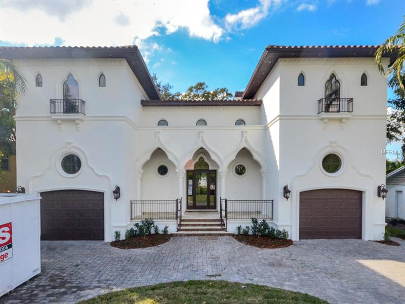 An upscale jewel in the midst of Davis Island, this 4 bedroom 3 bath completely remodeled home by Soleil Builders is a Must See. It is comfortably luxurious and will meet the needs of the most discerning buyers. The Mediterranean Revival design has Moorish embellishments, with the most striking feature being the vibrant painted ceiling in the Great Room. Moroccan artisans were commissioned to paint the coffered panels by hand, which were then shipped to the US from Casablanca. Brazilian walnut wood floors extend throughout the house, with Turkish travertine floors in the kitchen. High-end Wolf and Sub-Zero appliances, custom cabinetry and granite surfaces provide a kitchen to delight any chef, with the dining area at the rear with 8' tall windows.  A newly added theater room has electronics to control the entertainment and surround sound. Last but not least, the quality of the construction is evident, from the concrete maintenance-free soffits to the 35' deep foundation pilings. Double-paned and insulated Marvin windows and doors add security and Icynene Foam Insulation add fuel economy to the home, ensuring minimal electric bills. The split garages are designed for easy storage with staircase access to a loft area, in addition to spaces for large vehicles. Home should be completed by late march early April 2018. Still time to customize finishes. Do not miss out on this unique opportunity.