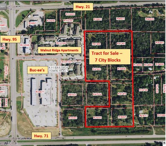 This property consists of 7 City blocks: 16.891 acres and would be great for mixed use commercial and large-scale apartment development.  However, the property is currently in the protected Houston Toad Habitat and would require US Fish & Wildlife permit for commercial development.  A 2018 toad study showed no toads and owner is pursuing a release from toad area restrictions.  Great vistas of Old Town Bastrop from the top of the hill.
