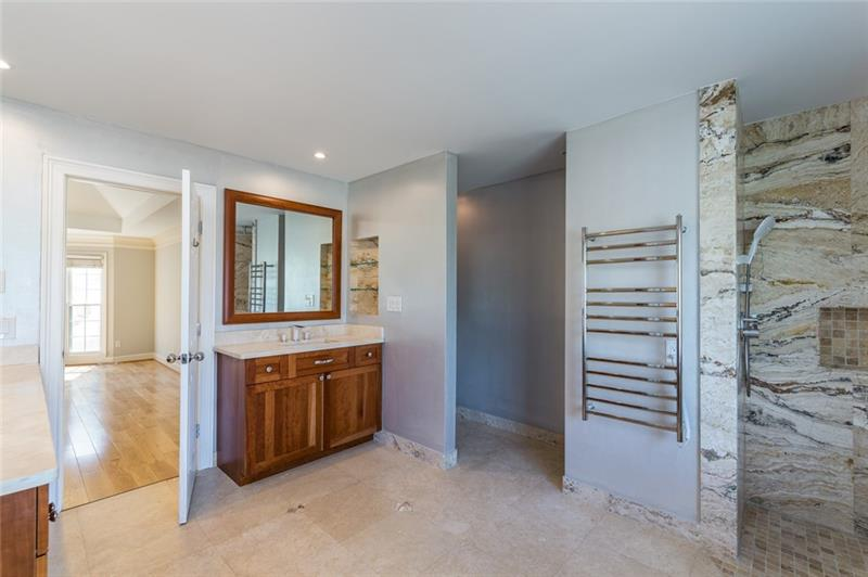 WOW! This master bath is truly something out of a magazine! Heated towel rack, oversized separate tub, large custom shower, great views of Sope Creek & more!