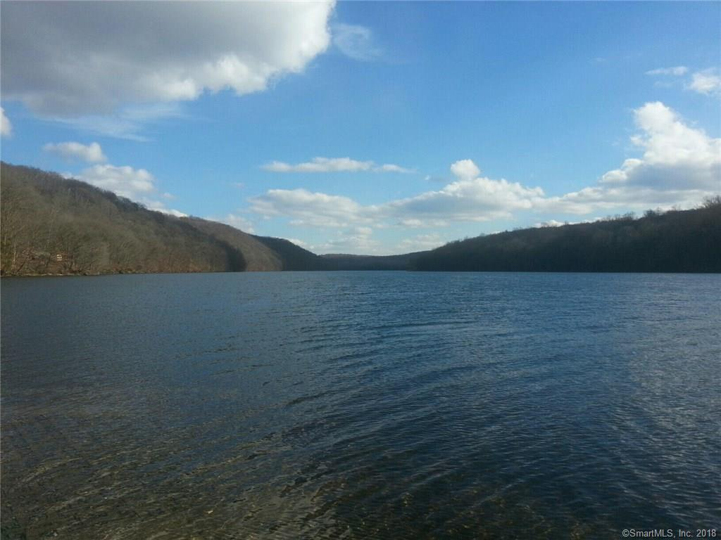 Waterfront retreat on Lake Lillinonah.  Thirteen private wooded acres acres  in the quiet area of Brookfield. Property abuts the town owned Old Bridge Sanctuary. Rustic style colonial home with all the modern features, Ideal for the weekend retreat or the full time private home. Subdivision possibilities.