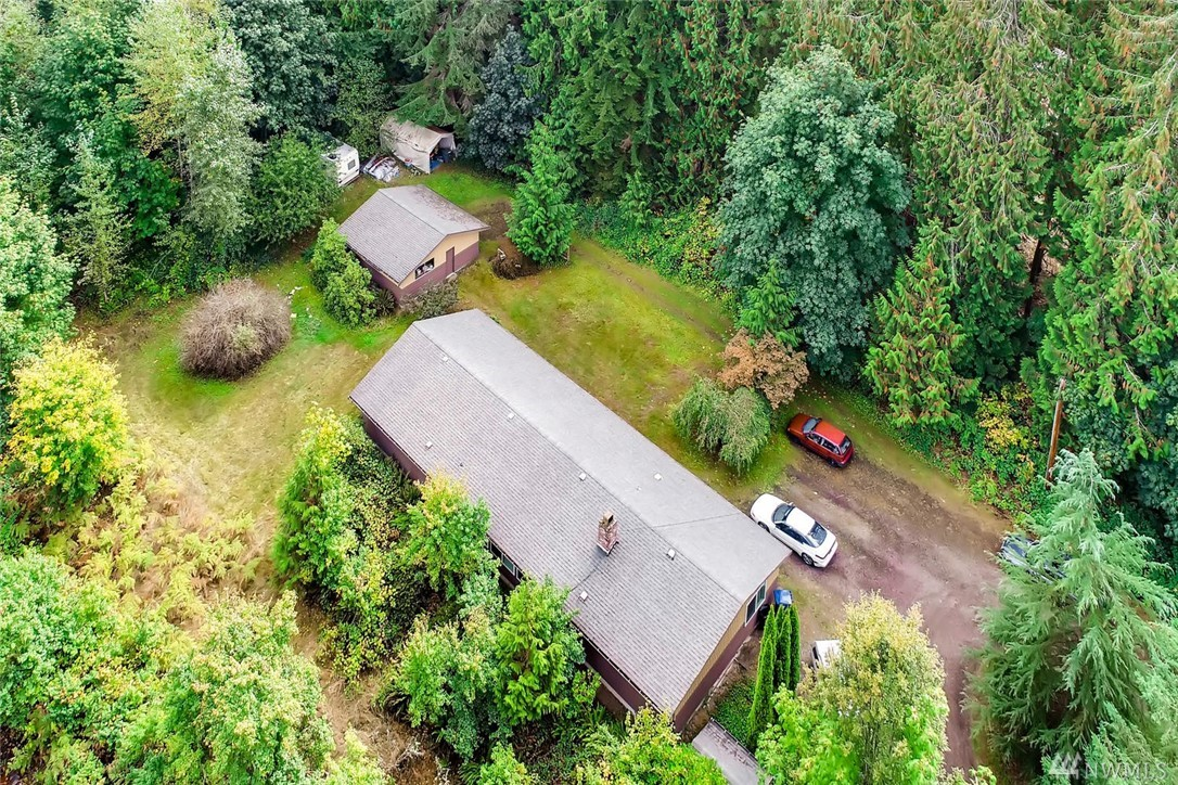 What's that sound?!? Opportunity! Classic rambler on apprx 4.85 usable acres. Enjoy the elbow room or subdivide: R-1 zoning allows for 5 lots. Prime Sammamish location, gas and water in street. Flexible floor plan offers inviting spaces, endless hrdwds, tile, some updating, applcs stay. Four bdrms include master suite; three baths. Open the doors to wide open spaces with room for toys and fun. Detached two-car garage, plus tons of off-street prkg. Buyer to verify all info to own satisfaction.