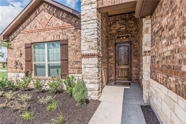 Shows like a model home; this home has 3 car garage, a gorgeous stone/stucco exterior and dramatic 8' ceilings with many upgrades and custom design features. A large study off the foyer and open dining room to welcome your guests in style. Kitchen is equipped with SS builtin appliances and beautiful stone island. 
