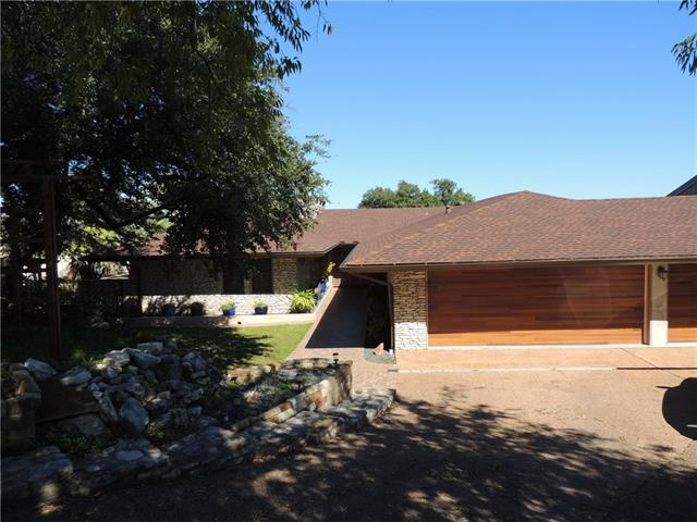 MUST SEE!! HUGE ROOMS, BACK TO 2ND HOLE OF LIVE OAK GOLF COURSE. RENOVATED IN 2004 AND 2014.HAND CARVED FIREPLACE,WOOD BLINDS, MAPLE CUSTOM KITCHEN CABINETS, LARGE ORGANIC FENCED GARDEN, ARBORS, MOSAIC TRAVERTINE FLOORS, HICKORY HARDWOOD FLOORS, FAUX FINISHED FRONT DOOR, 2 FIREPLACES, AND UPSTAIRS DECK. GREAT SCHOOLS CLOSE TO LAKE CLOSE TO SHOPPING. BUILT INTO SIDE OF HILL WHICH SAVES ON UTILITIES. OWNER/ AGENT CALL ME FOR MORE INFO.