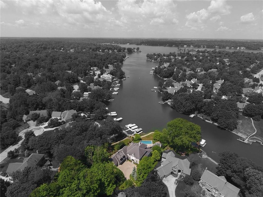 This home has been designed for Incredible Outdoor Living on Geist featuring Boat Dock & Lift, Pool House complete w/kitchen, fireplace, bath + shower steps away from your Infiniti Pool w/fountains overlooking the water! 5 car garage! Main level Master Retreat w/private balcony offering views of Geist, pool & pool house, gorgeous bath w/dual shower heads & spacious walk-in closet; Gourmet Kitchen w/2 dishwashers. Upstairs features 33x12 kids' retreat w/private access to firepit w/6 adirondack chairs included, BR's 2 & 3 w/jack-n-jill BA + BR 4 w/private BA! Finished Walk-Out Lower Level features Home Theater w/reclining theater chairs & audio/visual equipment included, wine cellar, wet bar & rec room w/fireplace. So many features, must see!