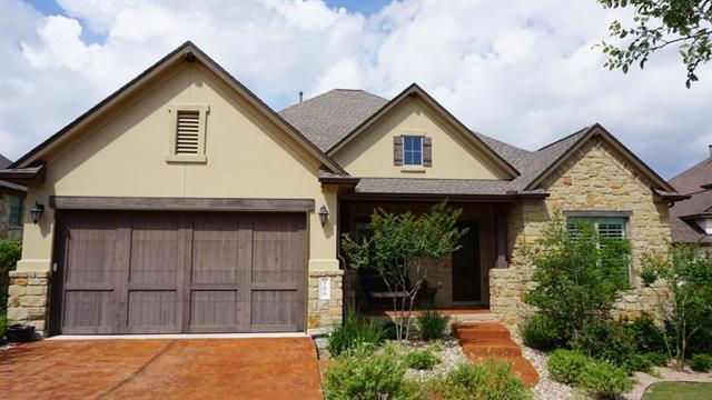 Avoid new construction with established neighbors and greenery. Green space views, large outdoor living prepped for outdoor kitchen, stereo, and flat screen tv. Cul-de-sac lot with front porch. Wood floors, gourmet kitchen with two islands, plantation shutters, and  home theater surround wiring. Walking distance from Highland Village, Rough Hollow's premier water park-themed amenity. Also near yacht club, restaurant, marina and work out facility. True lakeside living!