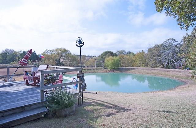 Wonderful opportunity at Lake Texoma! Own your own bed and breakfast with 4 separate homes on 12.41 acres.  Each home has it's own individual charm - Farm House, Early American, or a Cabin in the woods! Beautiful view of the ponds, walking trails and just minutes from the lake! Several of the homes will convey completely furnished.  Great chance to escape to the lake, while still earning an income!