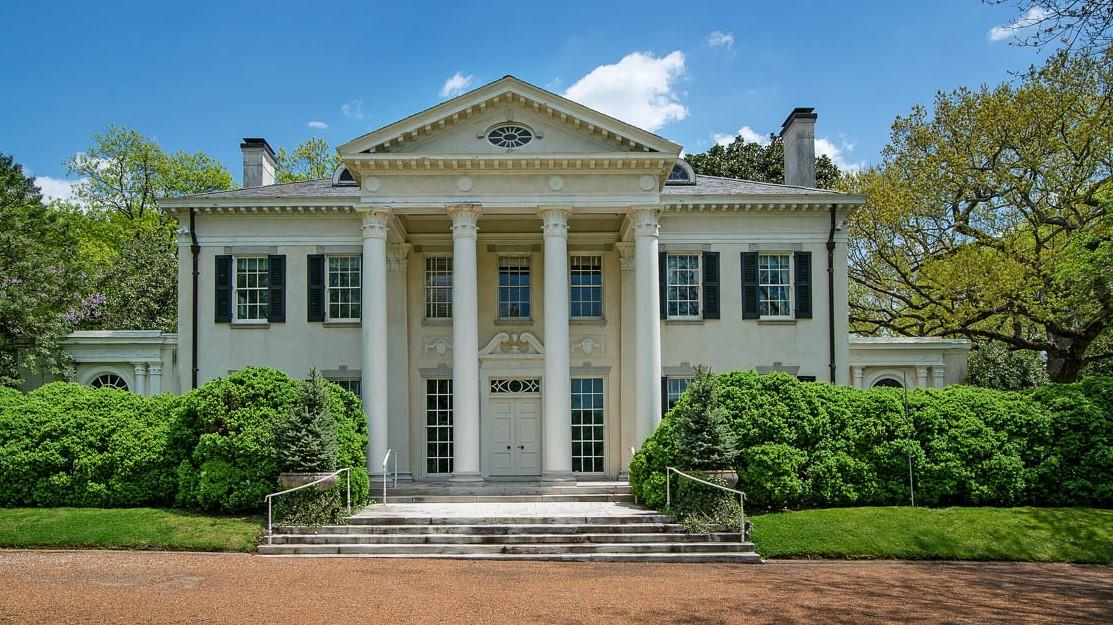 Iconic neoclassical residence. Remodeled and expanded in 1988. Extensive gardens designed by Ben Page, elaborate millwork, dramatic floating staircase in entrance hall, 10.4 ft ceilings down, storage galore incl silver closet, elevator, generator.