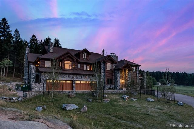 Rare offering. Grand, magnificent and awe-inspiring are descriptive terms that come to mind as you enter this spectacular estate in sought after Hangen Ranch.  Returning home each day from all that Colorado offers, the secluded mountainside setting will draw you in as you immerse yourself in luxury.  Experience inspirational view corridors across your meadow and up the valley to Mount Evans.  This home is a delight to entertain in boasting an incredible chef's kitchen including every imaginable appointment. An open concept design moves you from great room and dining room - flowing onto the western deck for Colorado postcard views.  Palatial master retreat includes a private study.  Elevator to all floors, a theater room, gym room and other flex spaces allow for your customization. 2000+ SF detached garage or convert to a horse barn.  45 mins to Downtown Denver. Approx 1 hour to DIA or World Class Skiing.  Don't miss the 3D virtual tour by clicking on the film reel under the photos.