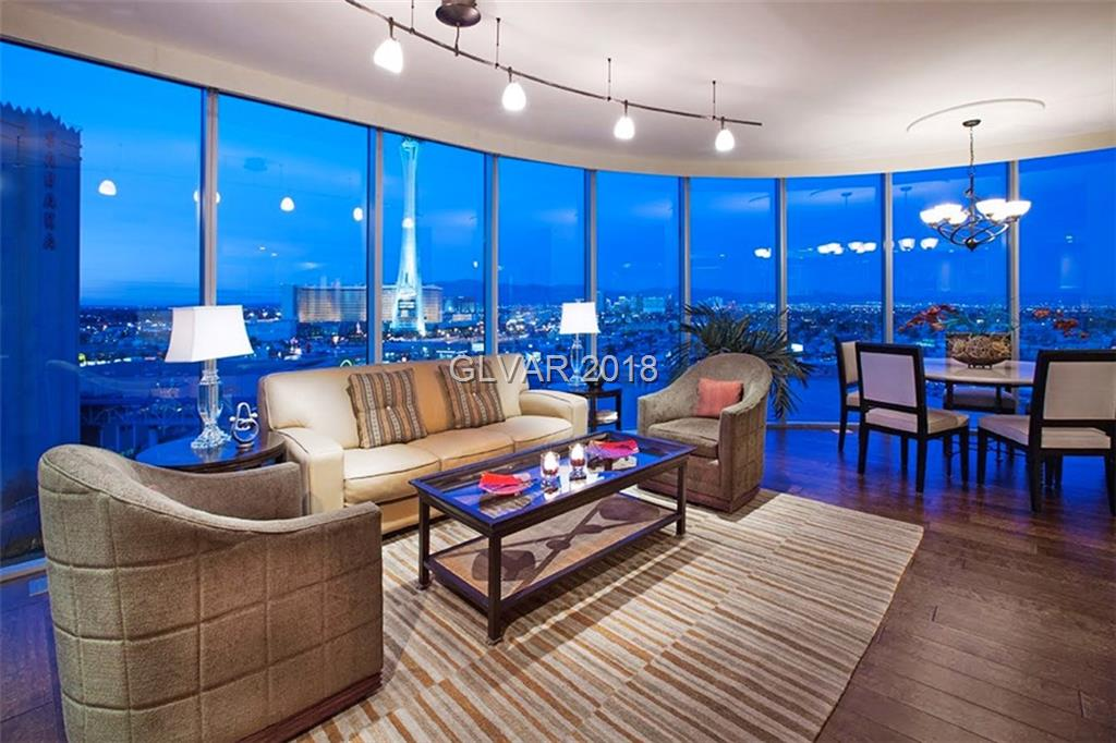 ABSOLUTELY FANTASTICE HIGH 30TH FLR RESIDENCE OFFERING THE MOST POPULAR FLOORPLAN WITH FLOOR TO CEILING CURVED WINDOWS! AWESOME STRIP & DOWNTOWN VIEWS TO THE SOUTH AND NORTH. OPEN LAYOUT WITH 2 BEDROOMS PLUS DEN/OFFICE. DEVELOPMENT OFFERS A RESORT-LIKE POOL, STATE OF THE ART FITNESS CENTER, VALET, GUARD GATED ENTRY, 24 HR SECURITY, TENNIS COURTS, ASSIGNED PARKING & STORAGE. THIS IS ONE OF THE BEST VALUES ON THE MARKET! PHOTOS ARE OF MODEL MATCH